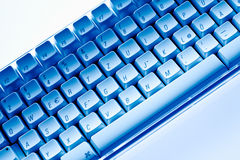 Computer keyboard close-up in blue ambiance Stock Image
