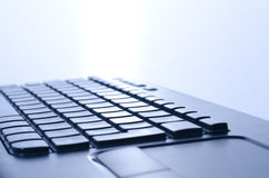 Computer keyboard. Close up of a computer keyboard with blue light Stock Photography