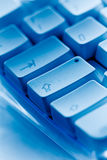 Computer keyboard close-up caps lock blue ambiance Royalty Free Stock Photo