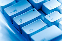 Computer keyboard close-up caps lock blue ambiance Stock Photo
