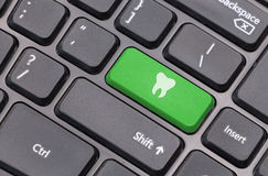 Computer keyboard closeup with tooth icon Stock Images