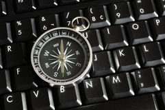 Computer keyboard and compass Stock Photo