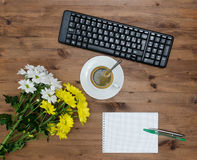 Computer Keyboard, cup coffee and flower Stock Image