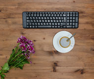 Computer Keyboard, cup coffee and flower Royalty Free Stock Photo