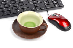 Computer keyboard and cup of tea Stock Photo