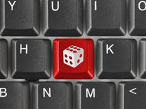 Computer keyboard with dice key Royalty Free Stock Images