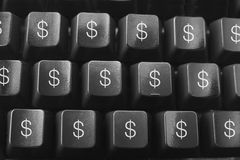 Computer Keyboard with Dollar Symbols Stock Photo