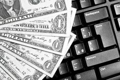 Computer keyboard with dollars, trading online Royalty Free Stock Photo
