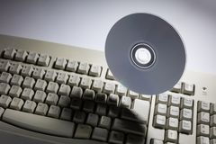 Computer keyboard and DVD disk stock photos