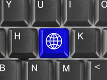 Computer keyboard with Earth key Royalty Free Stock Image