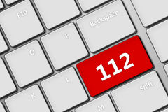 Computer keyboard with emergency number 112. Closeup of computer keyboard with emergency number 112 stock illustration