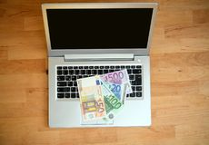 Computer keyboard with euro bank notes royalty free stock images