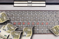 Computer keyboard with euro notes royalty free stock photos