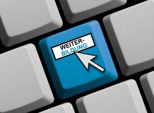 Computer Keyboard: Further Education german. Computer Keyboard with Mouse arrow showing Further Education in german language royalty free stock photo
