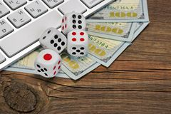 Computer Keyboard, Gaming Dices And Dollar Cash On Wood Backgrou Royalty Free Stock Image