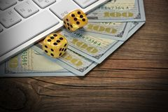 Computer Keyboard, Gaming Dices And Dollar Cash On Wood Backgrou Stock Photo