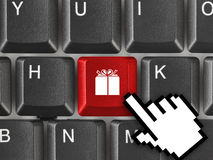 Computer keyboard with gift key Royalty Free Stock Photos