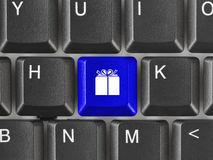 Computer keyboard with gift key. Business background Royalty Free Stock Photos