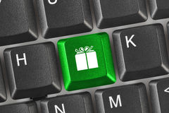 Computer keyboard with gift key Royalty Free Stock Images