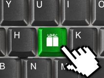 Computer keyboard with gift key Stock Photos