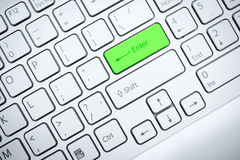 Computer keyboard with green button Stock Photo