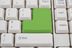 Computer keyboard - green key Royalty Free Stock Photo