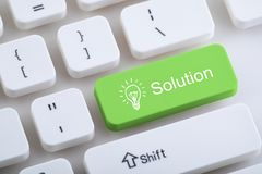 Computer keyboard with solution button stock photo