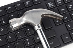 Computer keyboard and hammer Stock Photo