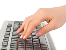 Computer keyboard and hand Stock Photo