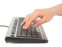 Computer keyboard and hand Stock Image