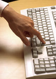 Computer keyboard and hand Royalty Free Stock Photography