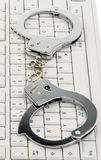 Computer keyboard handcuffs. Cybercrime. Royalty Free Stock Photography