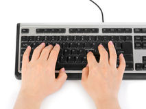 Computer keyboard and hands Royalty Free Stock Photo