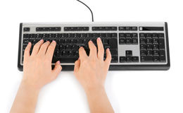 Computer keyboard and hands Stock Photo