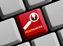 Computer Keyboard: Headhunter. Red Computer Keyboard with Magnifier Symbol showing Headhunter Royalty Free Stock Images