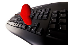 Computer keyboard and a heart isolated Stock Photos