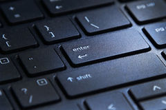 Computer keyboard with highlighted enter key. Laptop computer keyboard with highlighted enter key button Royalty Free Stock Photo