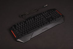 Computer keyboard isolated on black background. With soft shadow Stock Image