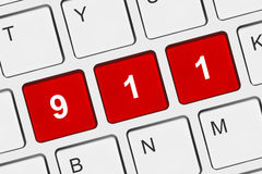 Computer keyboard with 911 key. Technology background Stock Images