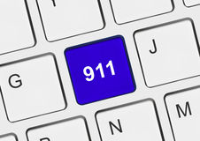 Computer keyboard with 911 key. Technology background Stock Photos
