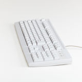 Computer keyboard lies on table surface Stock Photography