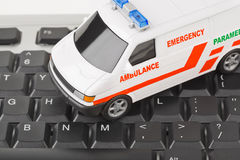 Computer keyboard and medical car Stock Photo