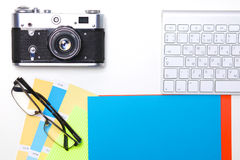 Computer keyboard, mouse and camera lie on table royalty free stock photography