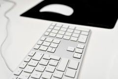 Computer keyboard and mouse. Computer keyboard with mouse on mouse pad isolated on white /grey background Stock Images