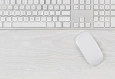 Computer keyboard and mouse on top of white desktop Royalty Free Stock Photography