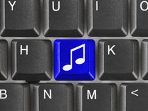 Computer keyboard with music key Royalty Free Stock Photos