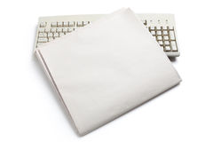 Computer Keyboard and Newspaper Stock Images