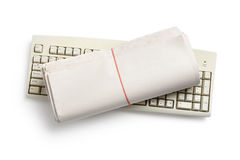 Computer Keyboard and Newspaper roll Stock Image