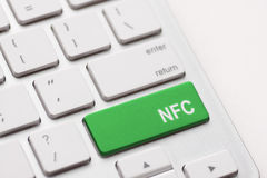 Computer keyboard with NFC technology. Message on keypad key Stock Photo