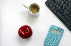 Computer keyboard, notebook, coffee on office desk,. Top view Royalty Free Stock Photos